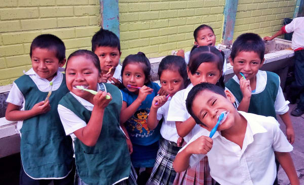 Source of Hope Kids Happily Brushing