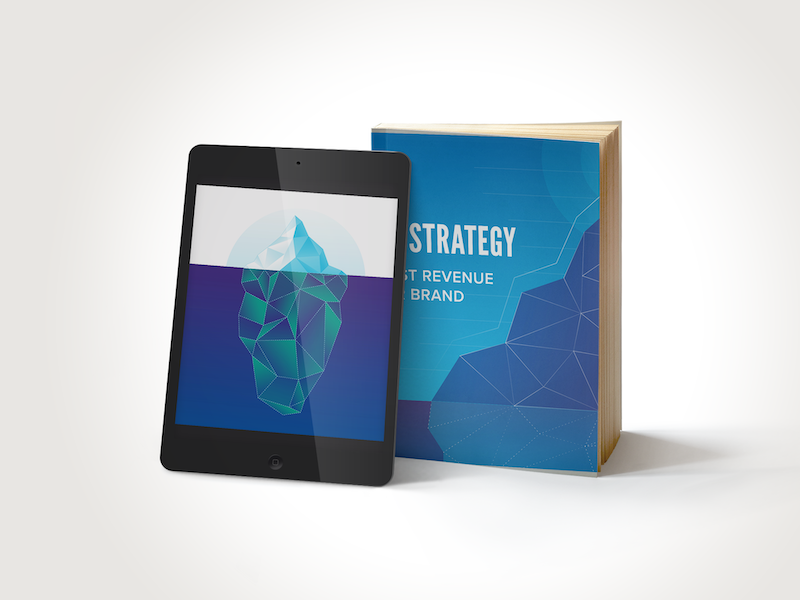 Tablet with iceberg illustration on screen and a blue book with words strategy revenue brand