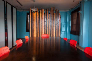 three red chairs in front of opened sliding panels