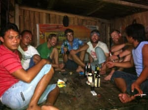 Nighttime drinking in a hut over the sea.