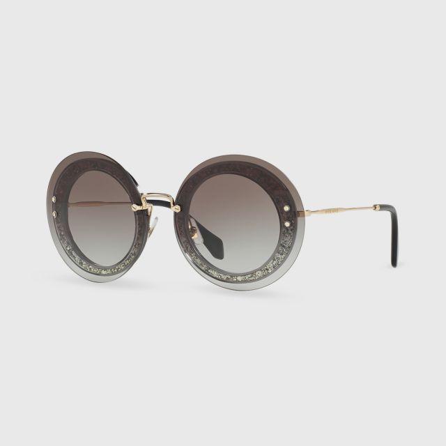 bee376e258a8 MIU MIU TRANSPARENT/FABRIC GLITTER SIL GREY GRADIENT Female Sunglasses