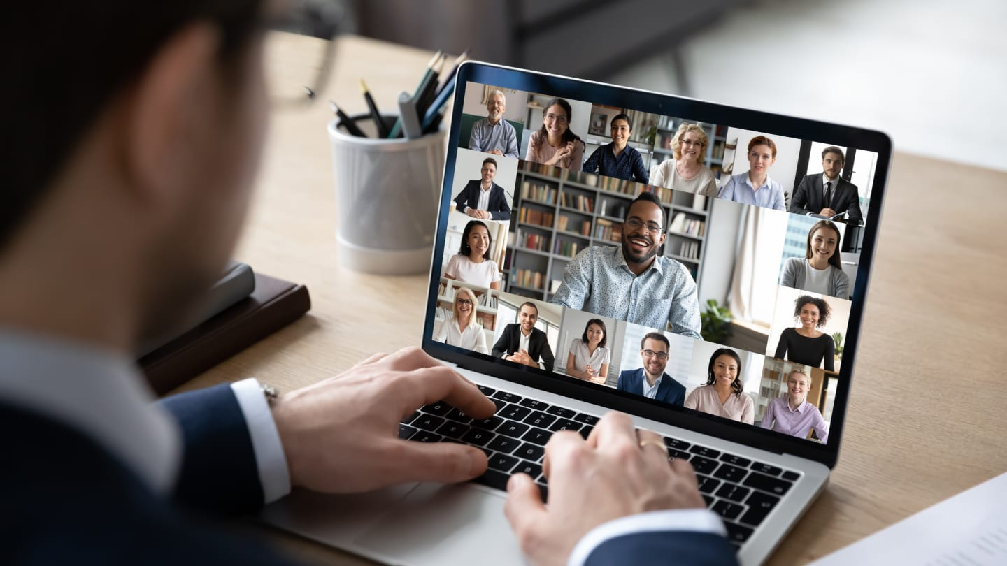 Businessman connecting with team via video conferencing