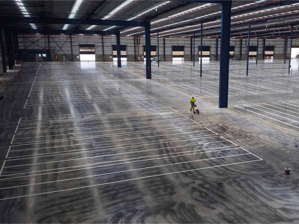 Creating lines in a warehouse where the shelves will be.