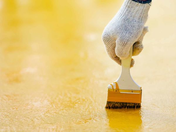 yellow epoxy floor coating brushing