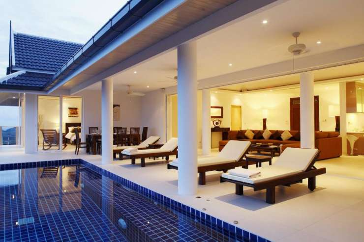 Andaman View (V02) - Spacious living room leading out onto the sundeck and swimming pool