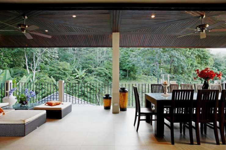 Sunstone Villa (V15) - Outside covered balcony, with soft seating and dining table