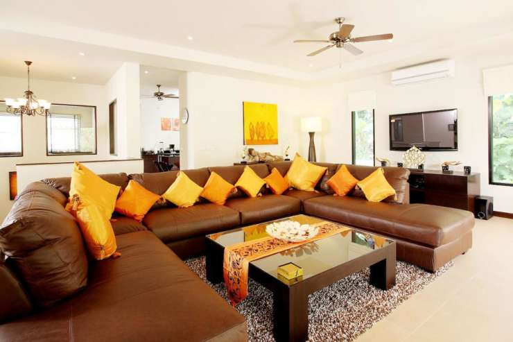 "Sunstone Villa (V15) - Large leather sofa in the living room, complete with 50"" flat screen TV"