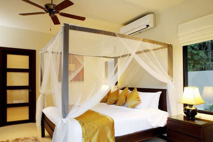 Sunstone Villa (V15) - Bedroom 2 with king-size bed, air conditioning, ceiling fan and en-suite bathroom