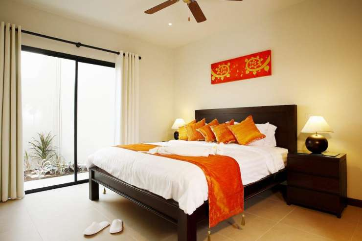 Sunstone Villa (V15) - Bedroom 4 with king-size bed and direct access to outside garden and swimming pool