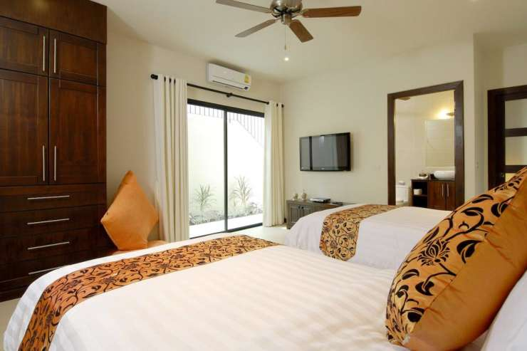 Sunstone Villa (V15) - Bedroom 5 with air conditioning, ceiling fan, en-suite bathroom and direct access to the outside