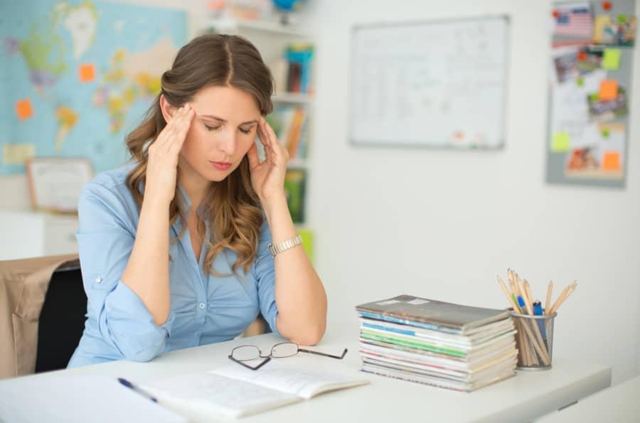 stressed teacher in classroom