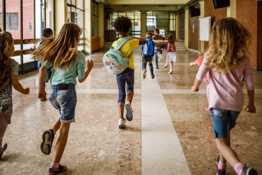 Children running down hallway