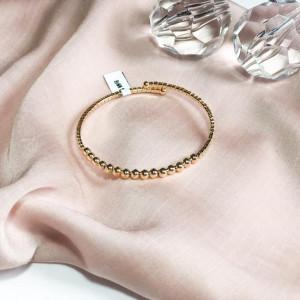 Bracelete aberto com zircônias cravejado e bolinhas