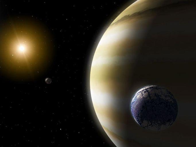Внесолнечная планета и её спутник в представлении художника.