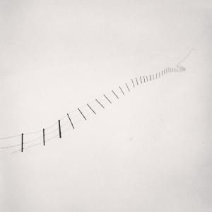Michael Kenna – Hillside Fence, Study 4, Teshikaga, Hokkaido, Japan