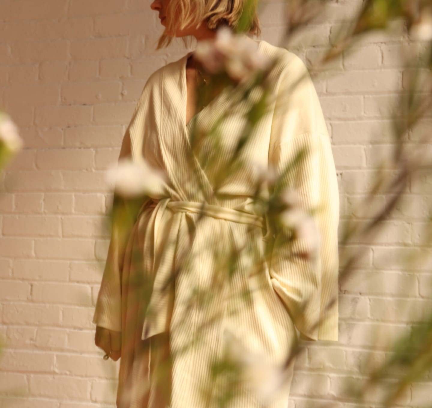 A photo of our co-founder, Mackenzie Yeates, in the Kotn Ribbed Robe.