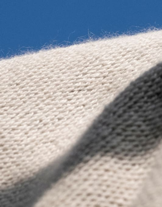 Close-up image of the inside of a Kotn hoodie fabric called loopback terry