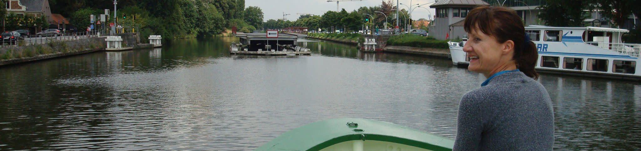 Patsie on barge Johanna Entering Bruges