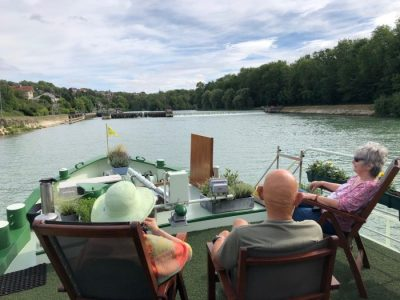 Relaxing on deck during a barge cruise
