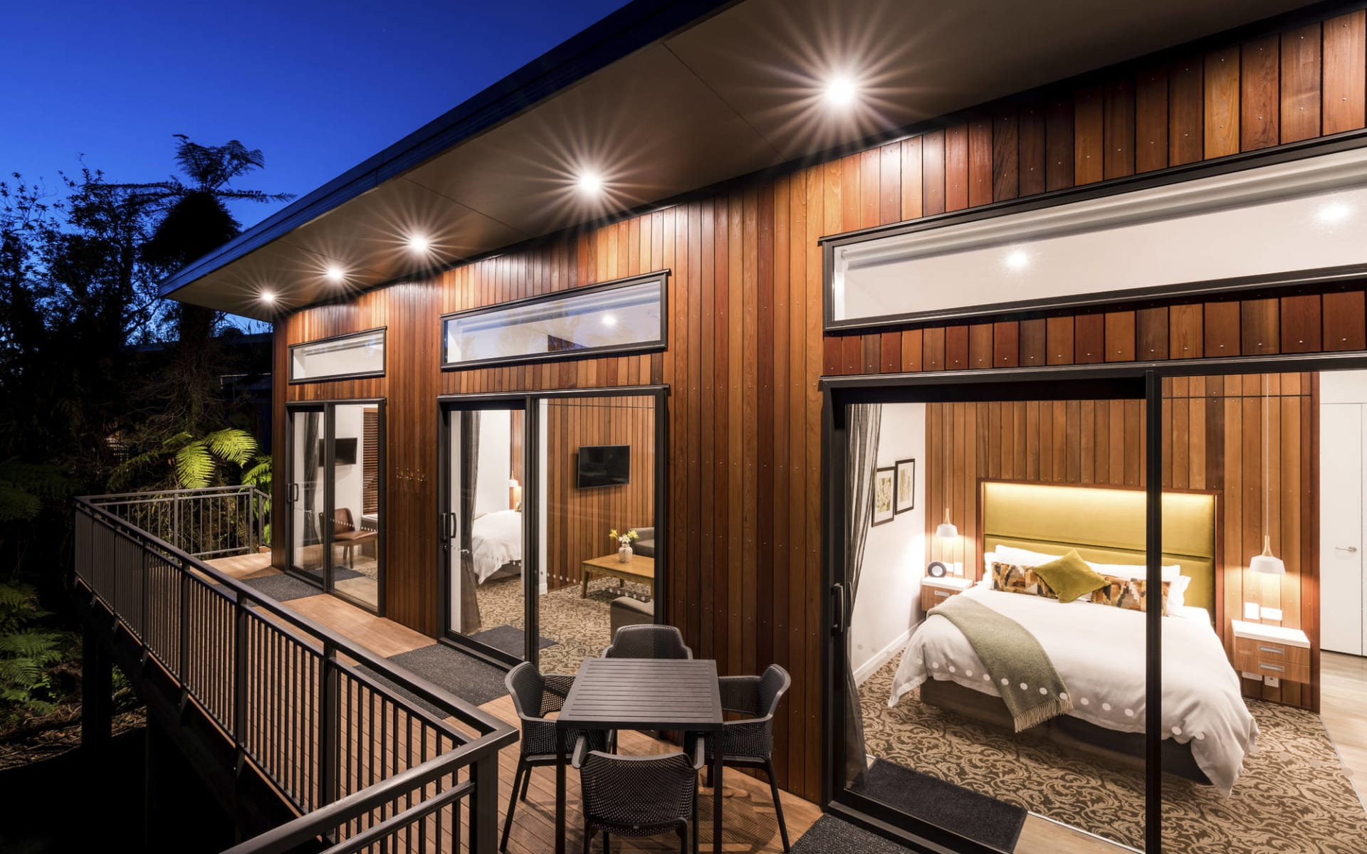 Rainforest Retreat Franz Josef:  TH_Ext_Deck-bedroom_Evening_1_L