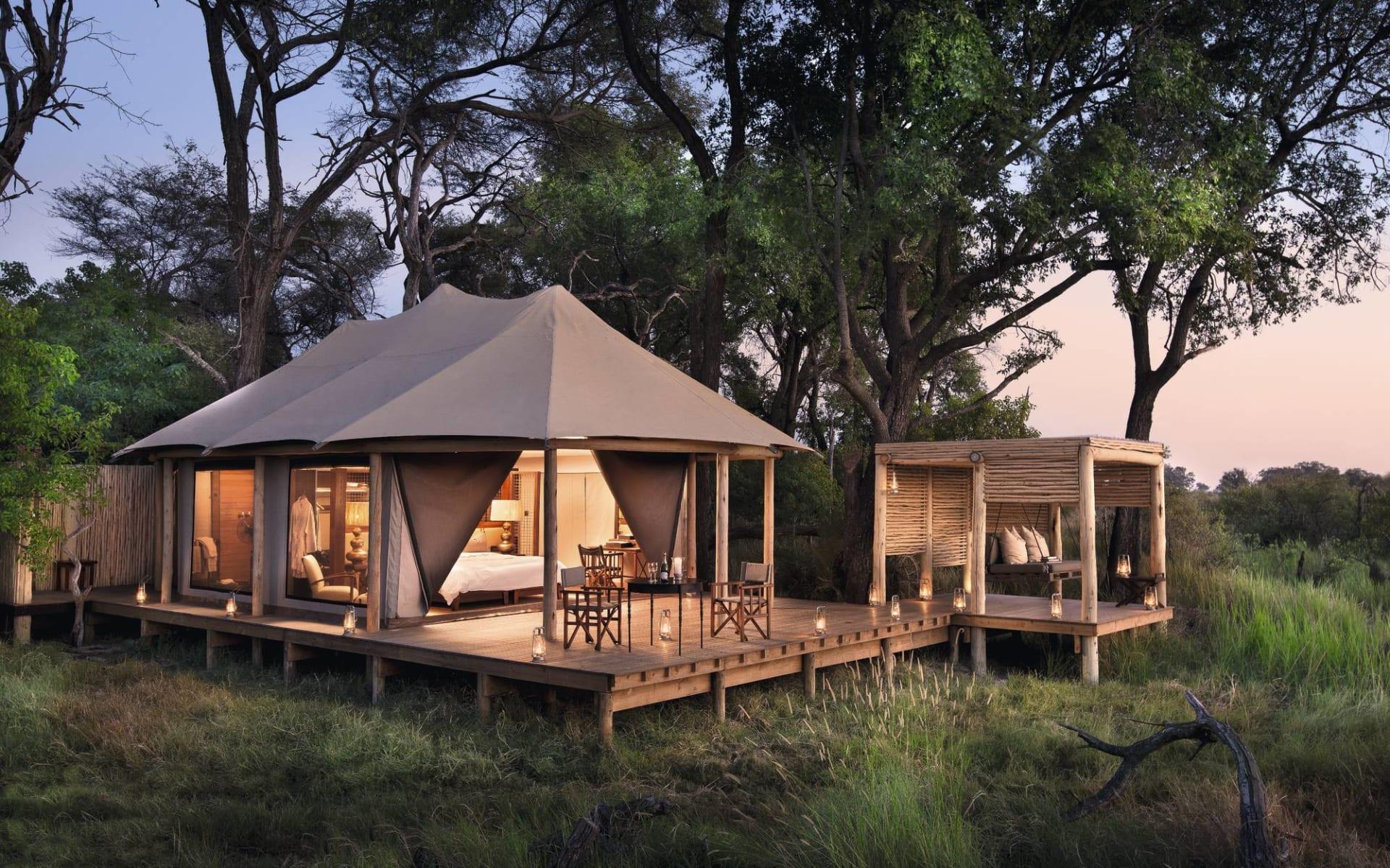 Nxabega Okavango Tented Camp in Okavango Delta: Nxabega Camp - Aussenansicht Zeltzimmer mit Sala c andbeyond$