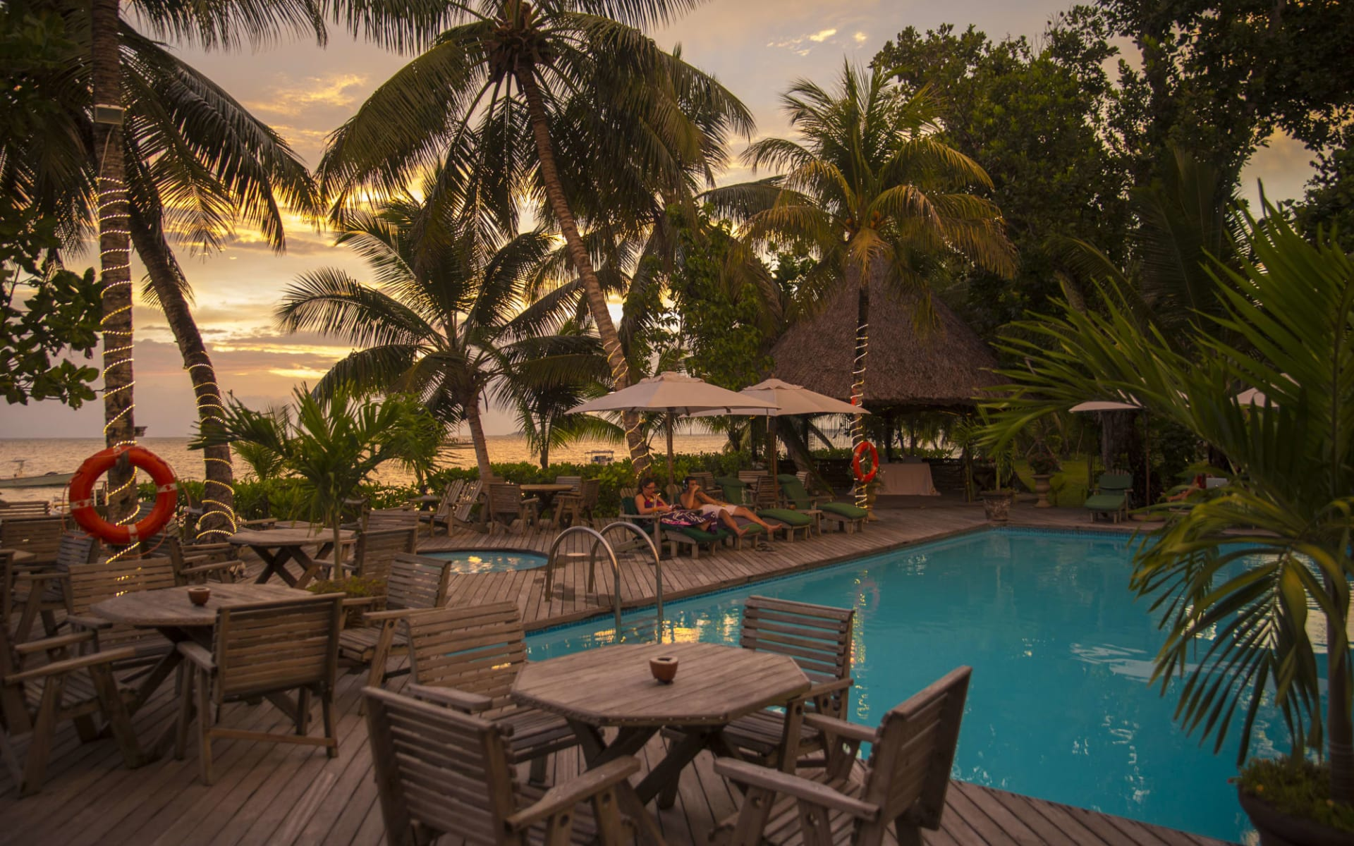 Indian Ocean Lodge in Praslin: Sunset by Pool