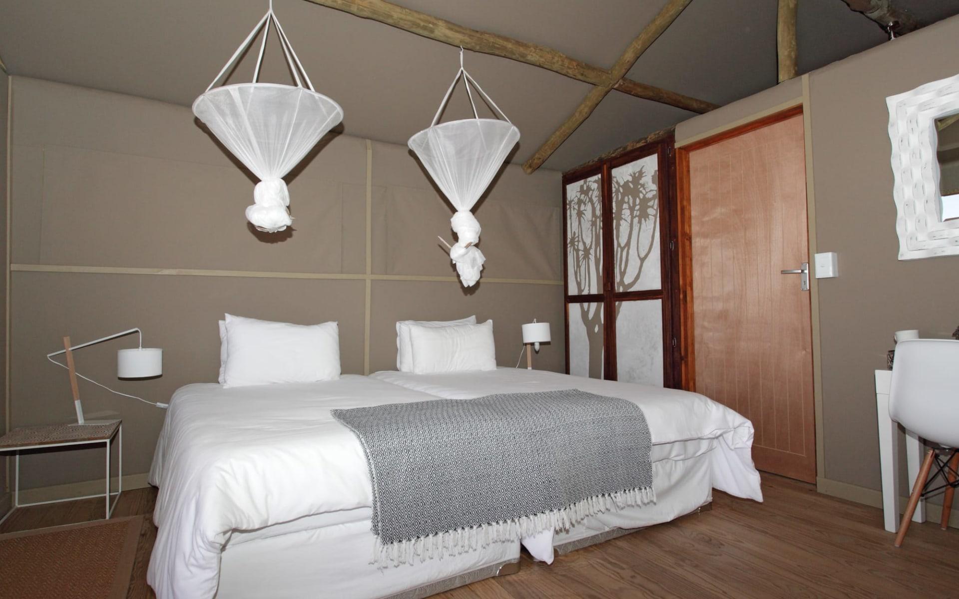 Kanaan Naankuse Desert Retreat in NamibRand Nature Reserve:  Kanaan Naankuse Desert Retreat - zimmer mit Bett