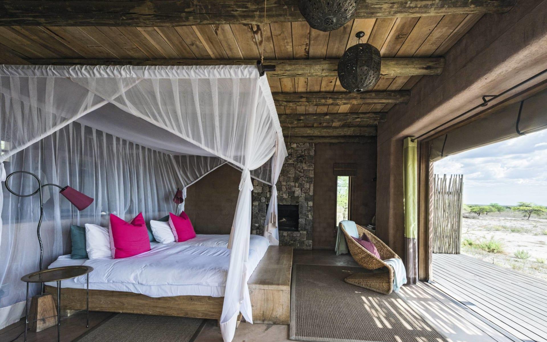 Onguma The Fort in Etosha Nationalpark: zimmer Onguma The Fort - Zimmer mit Bett und Aussicht