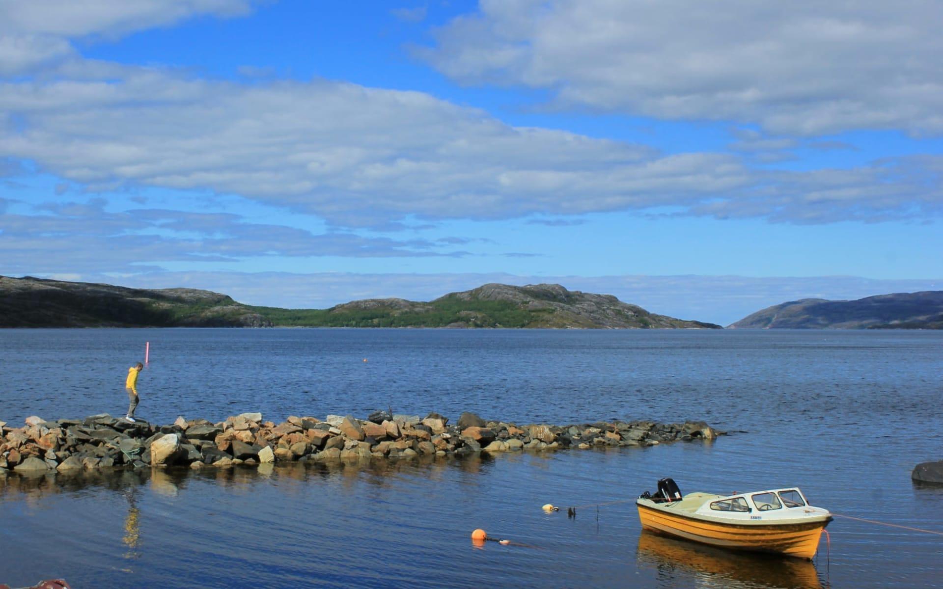 Thon Kirkenes: Yellow boat in a stone bay in Kirkenes, Norway