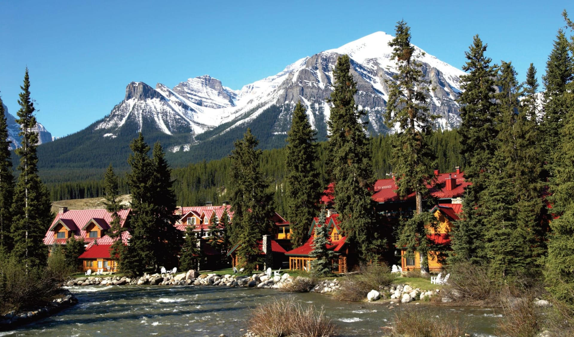 Post Hotel & Spa in Lake Louise:  Post Hotel & Spa_ExteriorWithPipestoneRiver