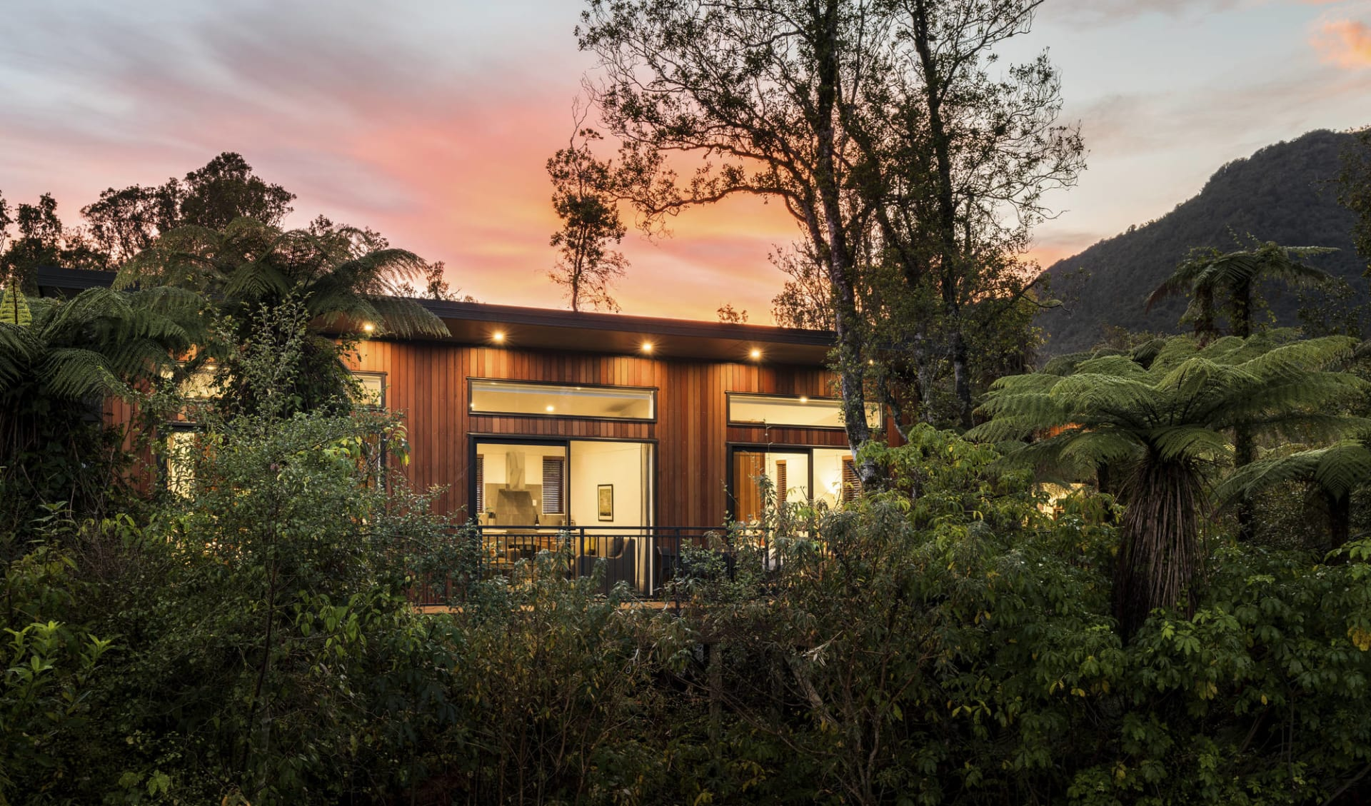 Rainforest Retreat Franz Josef:  TH_Ext_Front_Evening_1_L