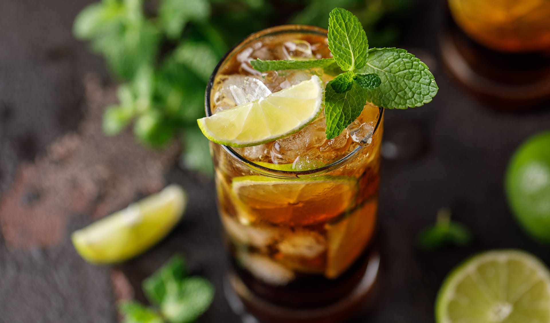 Cuba Libre with brown rum, cola, mint and lime.