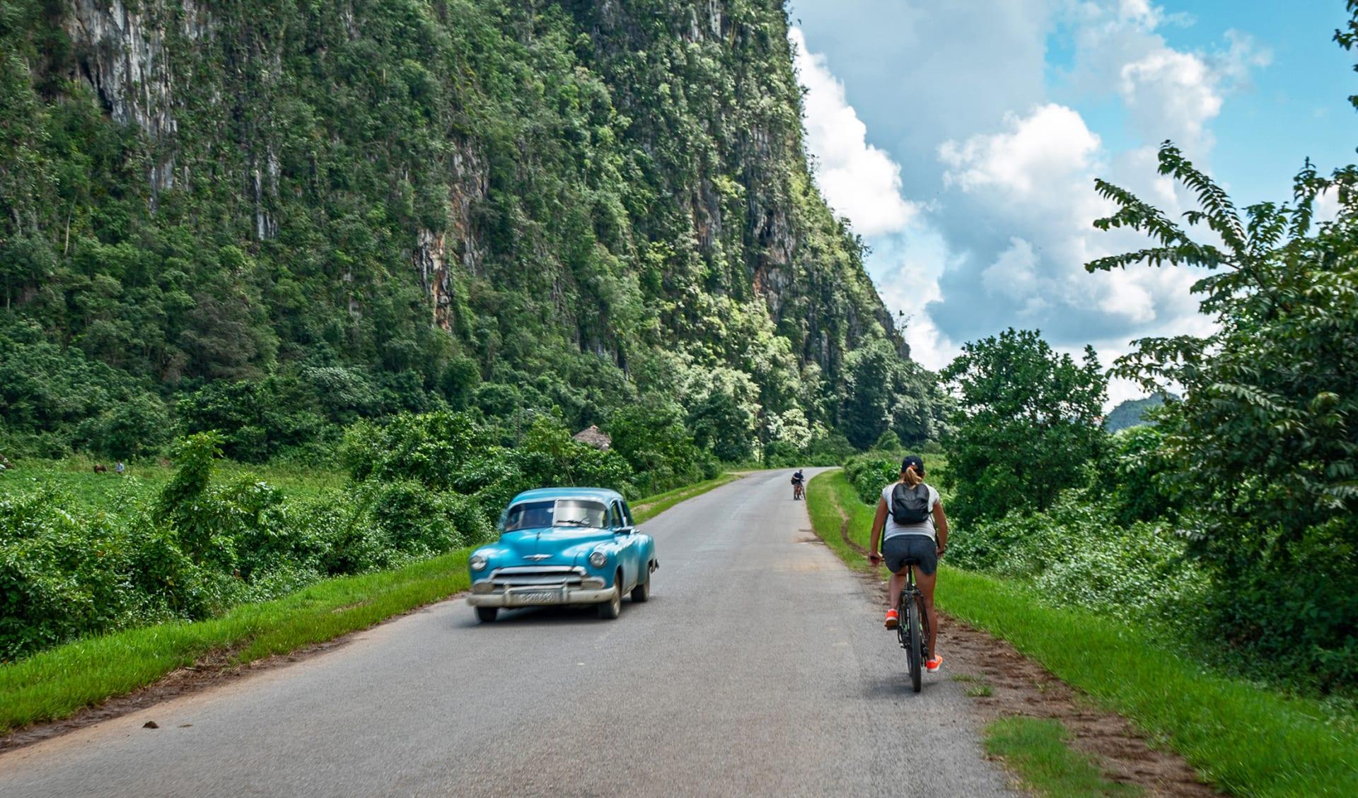 Girl riding on the bike in Viniales, Cuba