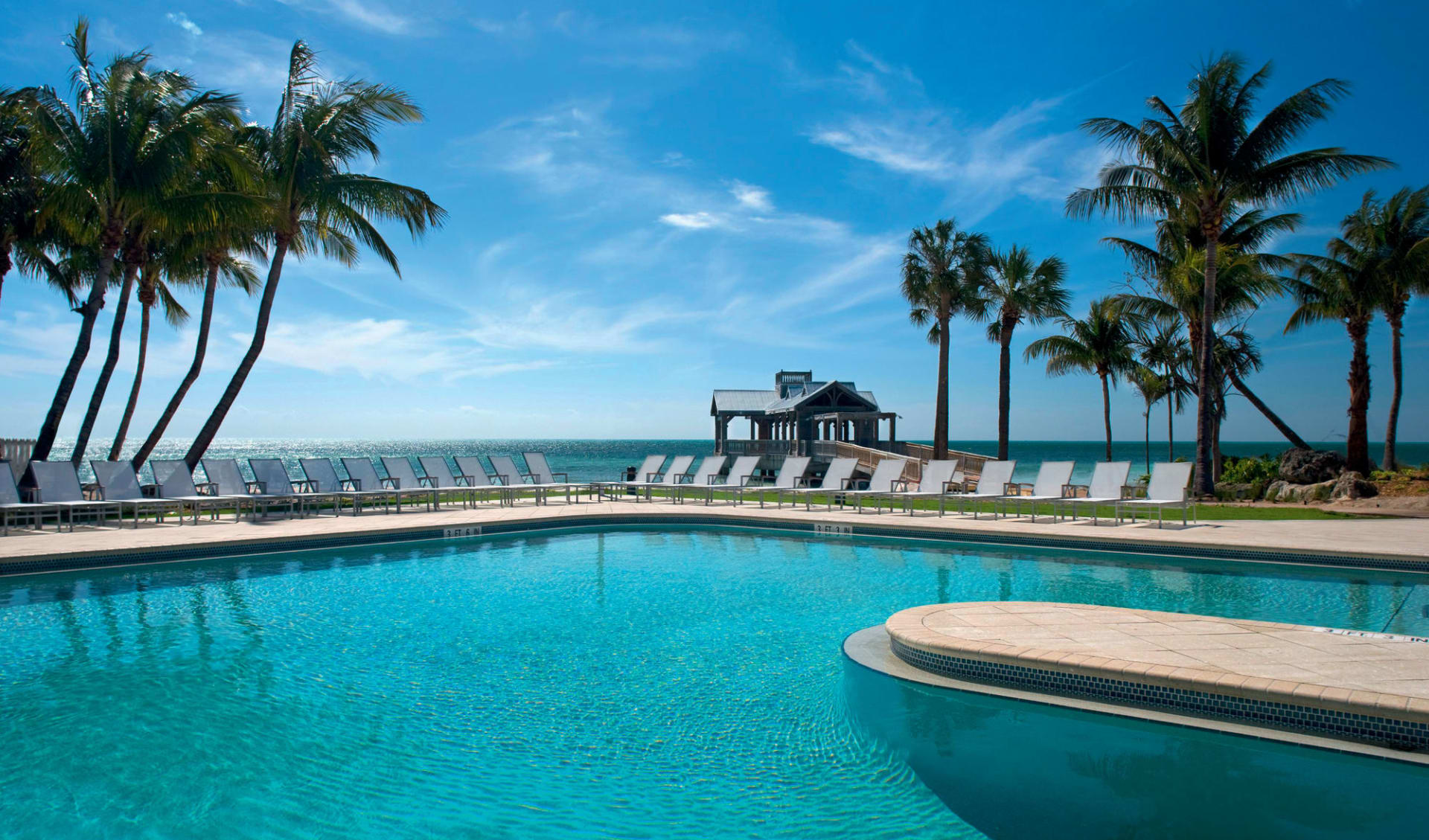 The Reach Key West, Curio Collection by Hilton: pool the reach resort key west liegestühle pool