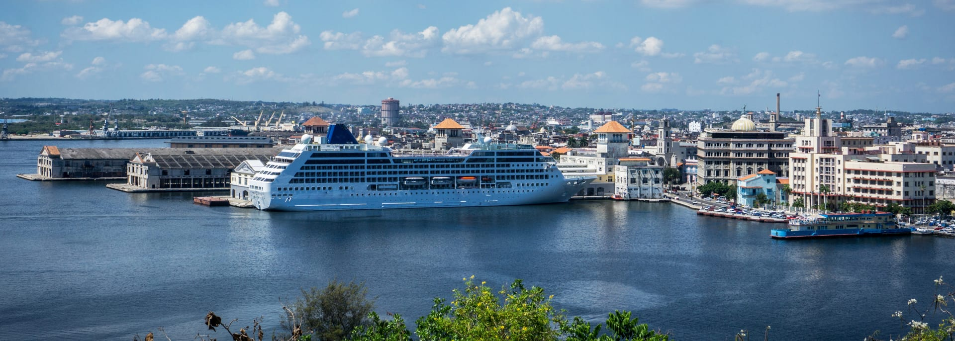 Sunset view from the Castillo De Los Tres Reyes Del Morro. A cruise ship sails from the Havana harbor.