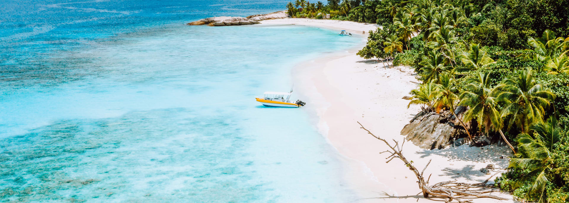 Blue lagoon and lonely tourist in seychelles