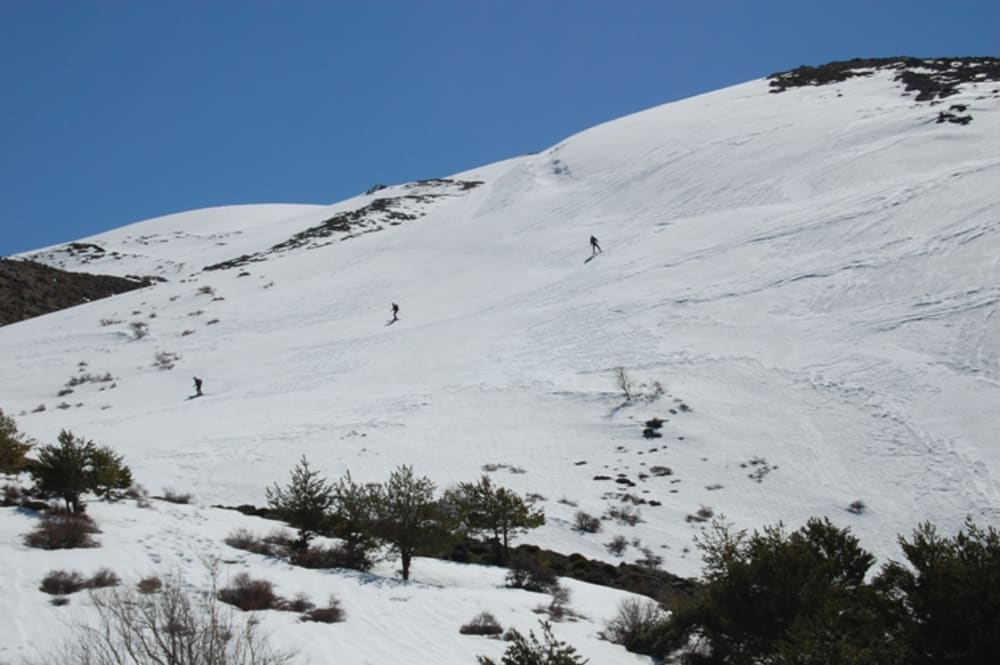 The 3 ski tourers making their way down to me