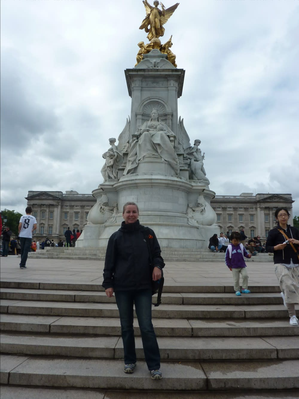 Me with Queen Victoria and Buckingham Palace behind