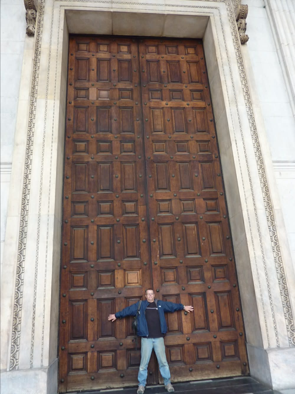 Why such big doors?? Richard stood showing the size of some doors at St Pauls Cathedral