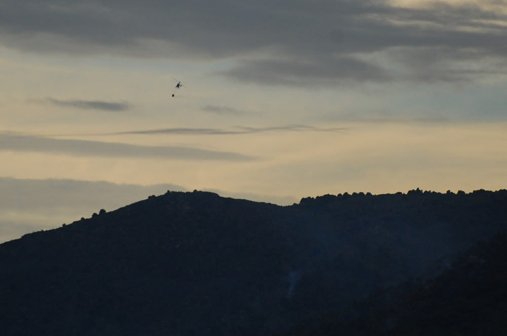 A helicopter silhouette as dusk sets in