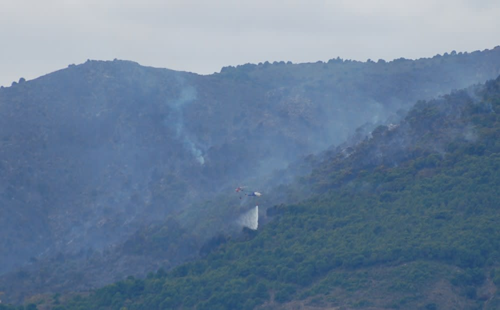 The fire is well under control now, 1 helicopter empties his water whilst the other goes off for a refill