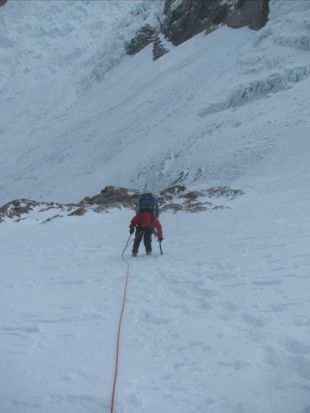 Me getting blasted by the wind on the steep section above the seracs