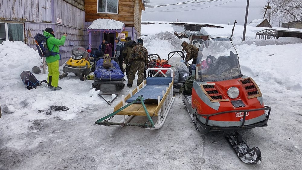 Packing up the snowmobiles