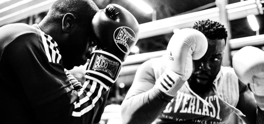Two men in a boxing match.