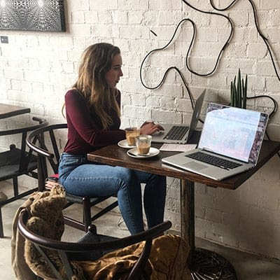 Bethany Barley sat at a cafe table facing a laptop