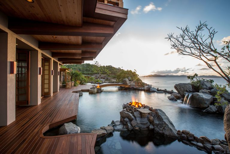 deck with view of water and rocks at British Virgin Island residence