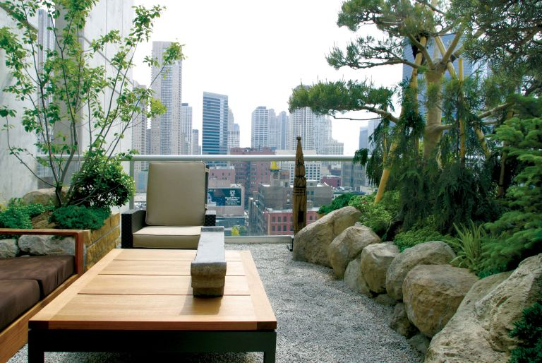 rooftop garden with chair and seating and trees, view of Chicago