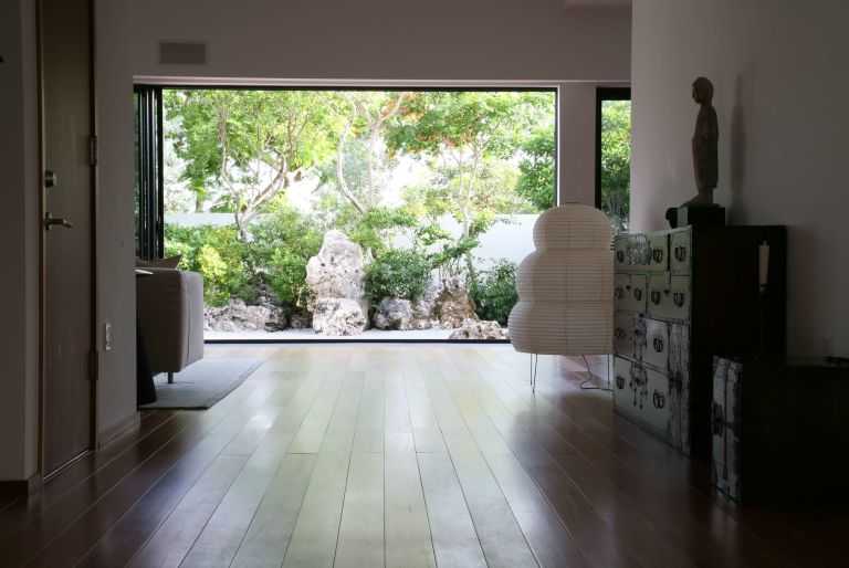 view of garden through doorway at Grand Cayman residence