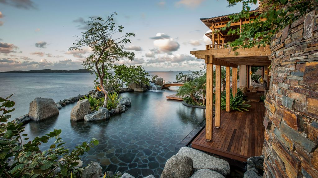 porch view of water with trees and rocks at British Virgin Island residence