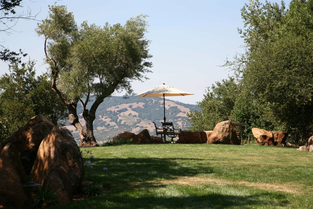 view of table and umbrella with mountain background at Brand Vineyards